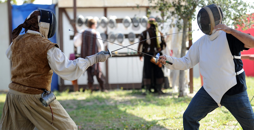 Description of . Fencing lessons on opening day of the Renaissance Pleasure Faire at Santa Fe Dam Recreation Area in Irwindale, Calif., on Saturday, April 5, 2014. 