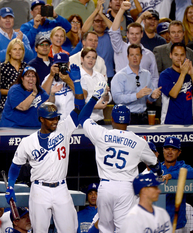 Description of . First up to bat Los Angeles Dodgers Carl Crawford brings in his first home run in the first inning as Hanley Ramirez celebrates with him during game 4 NLDS at Dodger Stadium Monday, October 7, 2013. (Photo by Sarah Reingewirtz/Los Angeles Daily News)