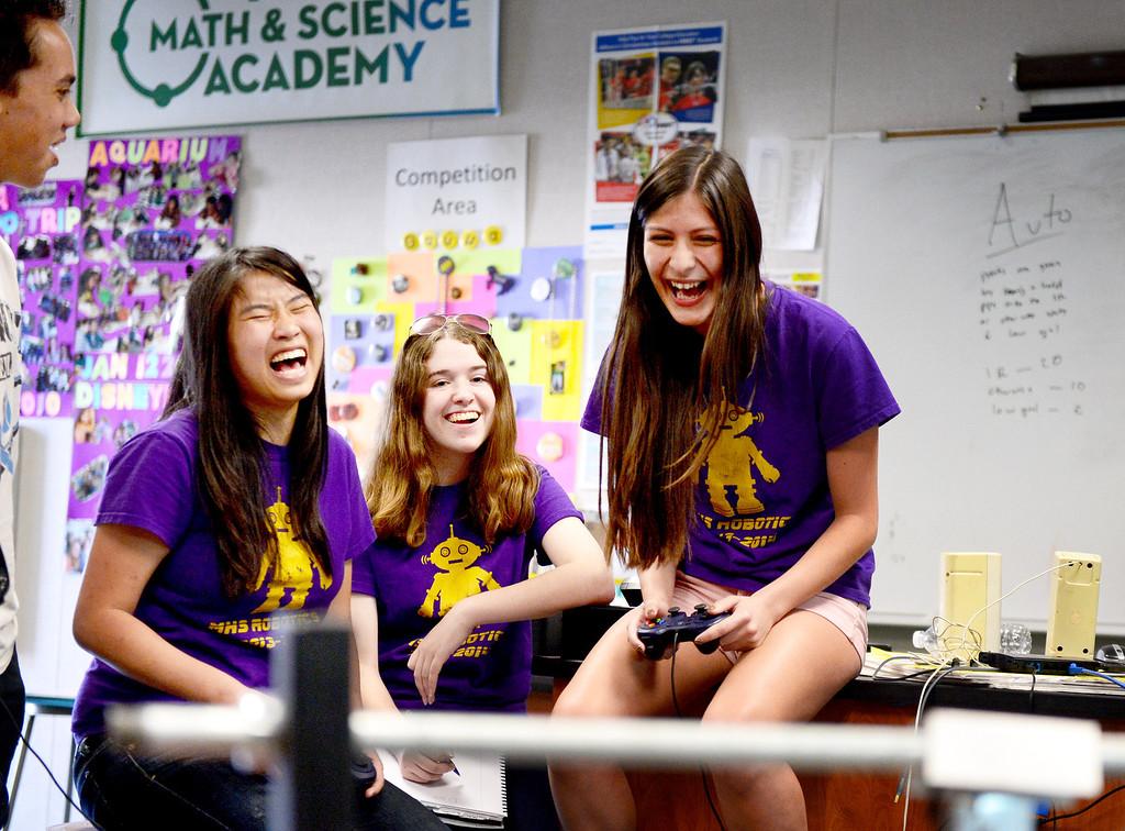 Description of . From left, Amanda Sullivan, 17, Emma McIntosh, 16, and Jordan Nuñez, 17, of The King and Queens, of Monrovia High's Robotics, react as their robot