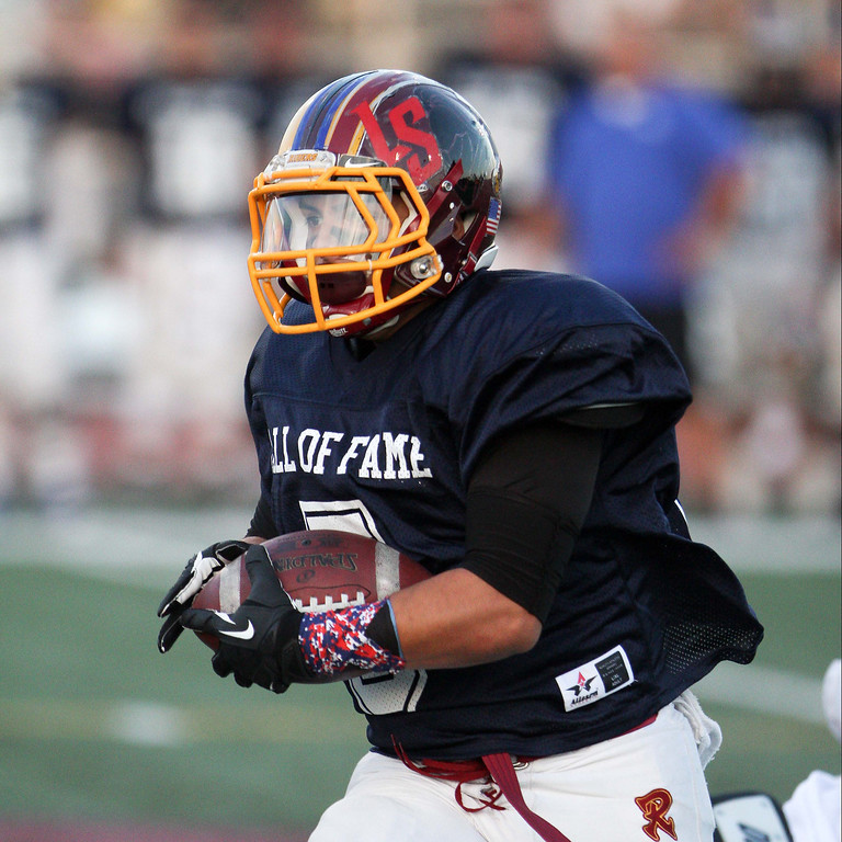 Description of . Roosevelt's Robert Taylor (5) runs for yardage during the 35th Annual Hall of Fame All-Star Football Game at West Covina High School in West Covina, CA on Friday, May 16, 2014. (Correspondent Photo by David Thomas for the Pasadena Star News)