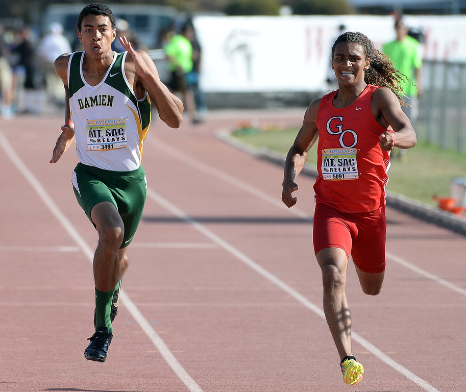 Description of . Damien's Thaddeus Smith, left, competes in the 200 meter Dash Invitational during the Mt. SAC Relays in Hilmer Lodge Stadium on the campus of Mt. San Antonio College in Walnut, Calif., on Saturday, April 19, 2014. 