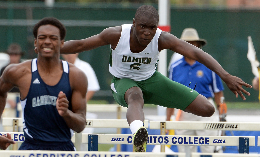 Description of . Damien's Kaodilichi Nwuda competes in the division 3 110 meter high hurdles during the CIF Southern Section track and final Championships at Cerritos College in Norwalk, Calif., Saturday, May 24, 2014. 