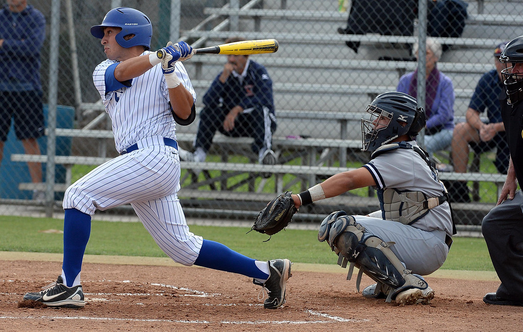 Description of . Bishop Amat's Michael Palos watches his RBI bases loaded single in the first inning of prep baseball game against La Salle at Bishop Amat High School in La Puente, Calif., on Tuesday, May 6, 2014. (Keith Birmingham Pasadena Star-News)