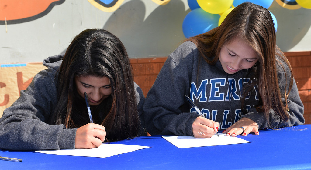 Description of . Girls Soccer players Ileen Mejia, left, and Samantha Scovel, sign their letters of intent to attend Mercy College during National Signing Day at La Mirada High School on Wednesday February 5, 2014. (Staff Photo by Keith Durflinger/Whittier Daily News)