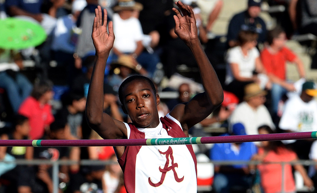 Description of . Alemany's Earnest Sears competes in the high jump during the CIF-SS Masters Track and Field meet at Falcon Field on the campus of Cerritos College in Norwalk, Calif., on Friday, May 30, 2014.   (Keith Birmingham/Pasadena Star-News)