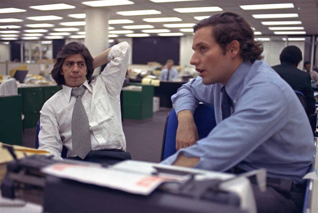 Description of . In this May 7, 1973, file photo, reporters Bob Woodward, right, and Carl Bernstein, whose reporting of the Watergate case won them a Pulitzer Prize, sit in the newsroom of the Washington Post in Washington. On Monday, Aug. 5, 2013, the Washington Post announced the paper has been sold to Amazon founder Jeff Bezos. One of key dates in the history of The Washington Post was when the Post began reporting on the break-in at the Democratic National Committee's offices at Washington's Watergate hotel. (AP Photo)