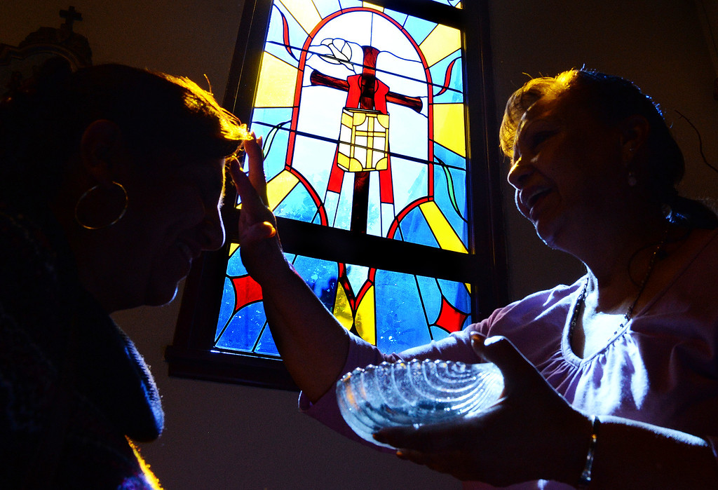 Description of . A parishioner at Our Lady of Carmel Church in Rancho Cucamonga receives ashes on her forehead to mark the beginning of Lent on Ash Wednesday March 5, 2014.  (Will Lester/Inland Valley Daily Bulletin)