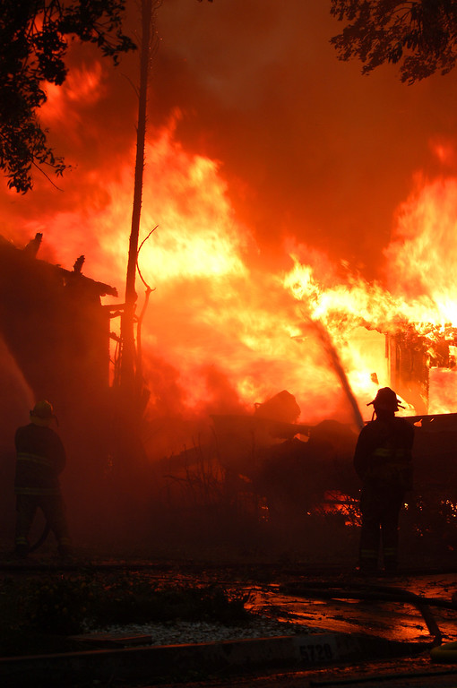 Description of . Ten years ago this month the arson caused Old Fire, fanned by Santa Ana winds burned thousands of acres, destroyed hundreds of homes and caused six deaths. The fire burned homes in San Bernardino, Highland, Cedar Glen, Crestline, Running Springs and Lake Arrowhead and forced the evacuation of thousand of residents.  A fire fighter battles the Old Fire just north of Marshal and Elm in San Bernardino on Saturday October 25, 2003. (Staff file photo/The Sun)