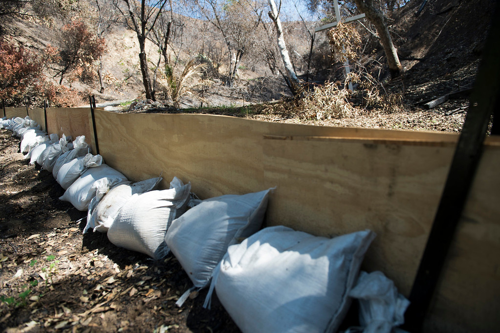Description of . Sandbags are stacked in 1100 block of Englewild Drive in Glendora on Tuesday, Feb. 25, 2014 as residents prepare for two major rainstorms that will hit the region this week that potentially will cause mudslides in the area devastated by the Colby Fire. (Photo by Watchara Phomicinda/ San Gabriel Valley)