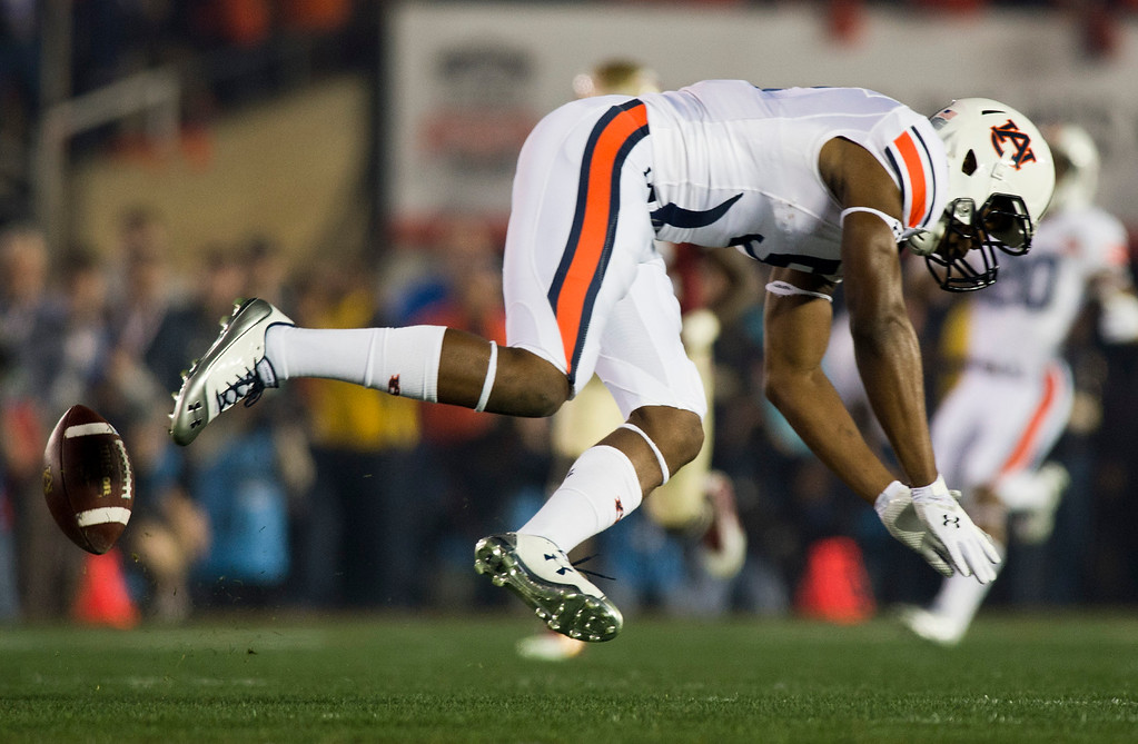 Description of . Ricard Louis (5) of Auburn attempts to make a catch in the first half of the BCS National Championship game at the Rose Bowl in Pasadena Calif. on Monday, Jan. 6, 2014. (Watchara Phomicinda/ Pasadena Star-News)