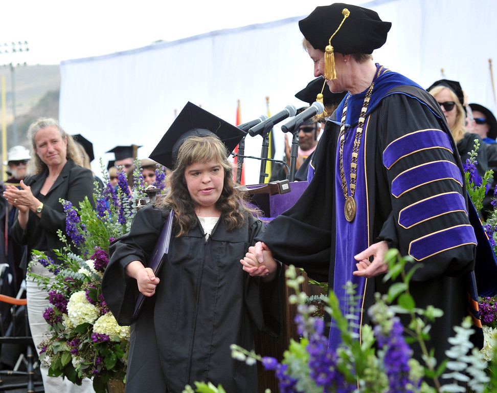 Description of . Susan Rubin, who is diagnosed with autism, receives applause as she receives her diploma from President Sharon Herzberger during the 110th Commencement Ceremony at Memorial Stadium on the Whittier College campus in Whittier on Friday May 17, 2013. Award-winning journalist Sonia Nazario gave the keynote address and received an honorary degree from the Whittier College faculty: a doctorate of humane letters.(SGVN/Staff Photo by Keith Durflinger)