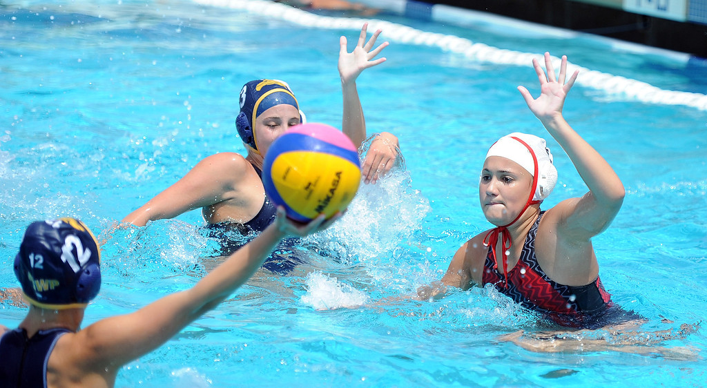 Description of . Conquerors of Hacienda Heights, left, vs. North Allegheny team from Pennsylvania during the USA Water Polo Junior Olympics at Splash! La Mirada Regional Aquatics Center on Thursday, Aug. 1, 2013 in La Mirada, Calif. 