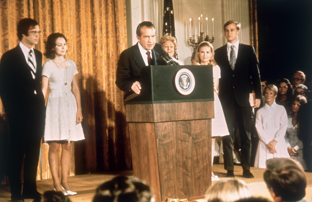 Description of . American politician Richard Nixon (1913 - 1994) at the White House with his family after his resignation as President, 9th August 1974. From left, son-in-law David Eisenhower, Julie Nixon-Eisenhower, Richard Nixon,  Pat Nixon (1912 - 1993), Tricia Nixon and her husband Edward Cox, August 1974. (Photo by Keystone/Hulton Archive/Getty Images)
