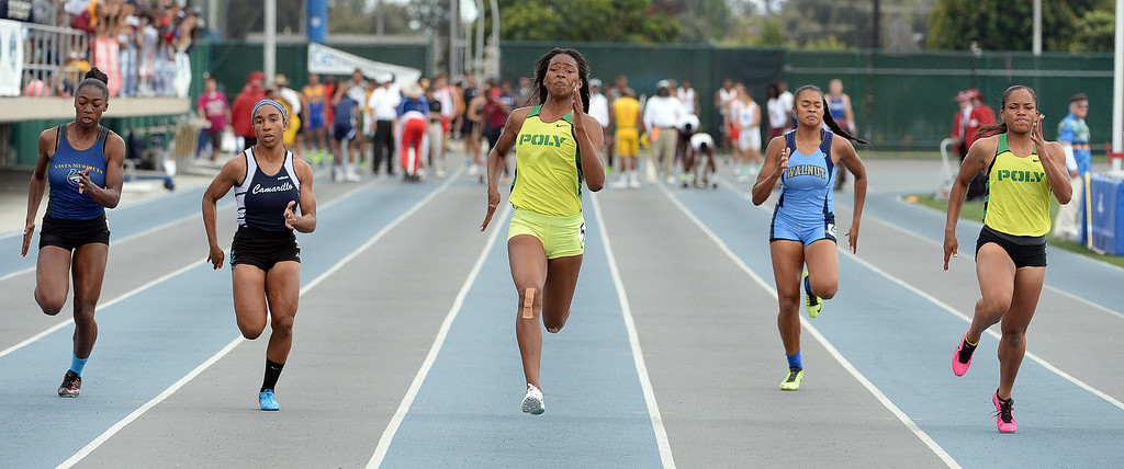 Description of . Long Beach Poly's Arianna Washington wins the division 1 100 meter dash during the CIF Southern Section track and final Championships at Cerritos College in Norwalk, Calif., Saturday, May 24, 2014. 