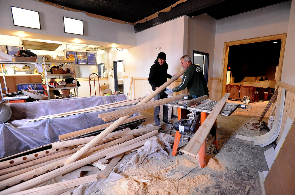 Description of . Peter Grote, right, does some wood work in The Cave Theater in Big Bear Lake May 6, 2013.  The music venue, which was originally a movie theater, is set for a grand re-opening for June 7.  GABRIEL LUIS ACOSTA/STAFF PHOTOGRAPHER.