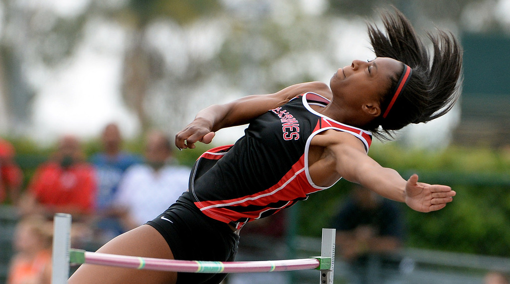 Description of . Harvard Westlake's Alexandria Florent competes in the division 3 high jump during the CIF Southern Section track and final Championships at Cerritos College in Norwalk, Calif., Saturday, May 24, 2014. 