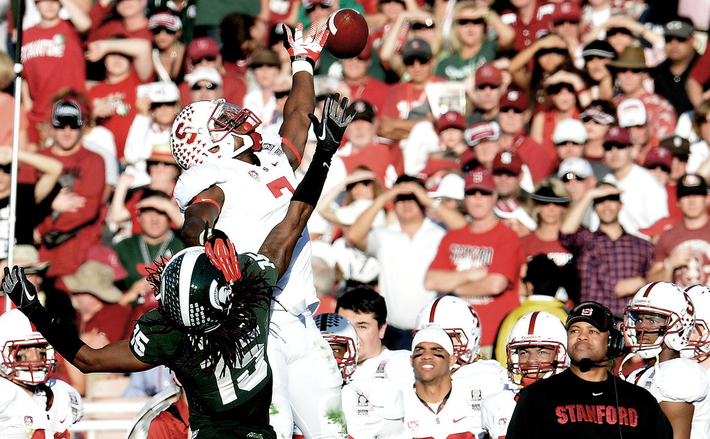 Description of . Stanford wide receiver Ty Montgomery (7) can't reach a pass as Michigan State cornerback Trae Waynes (15) defends in the first half of the 100th Rose bowl game in Pasadena, Calif., on Wednesday, Jan.1, 2014. 