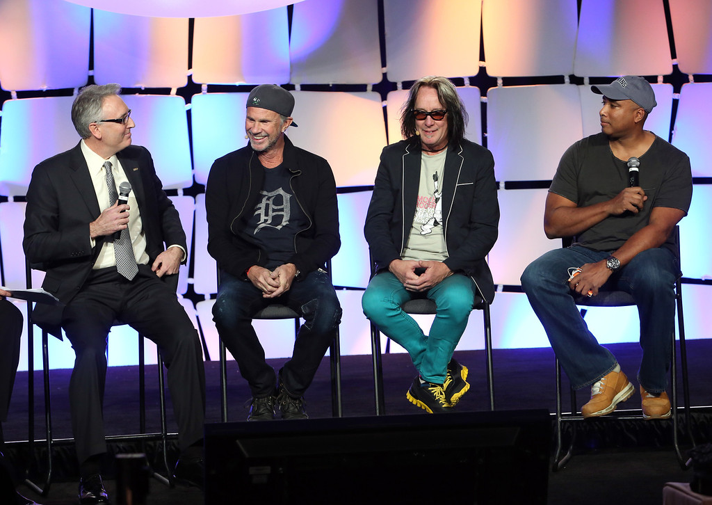 Description of . ANAHEIM, CA - JANUARY 24:  NAMM President and CEO Joe Lamond, Drummer Chad Smith, recording artist Todd Rundgren and Baseball player Bernie Williams attend the 2014 National Association of Music Merchants show at the Anaheim Convention Center on January 24, 2014 in Anaheim, California.  (Photo by Jesse Grant/Getty Images for NAMM)