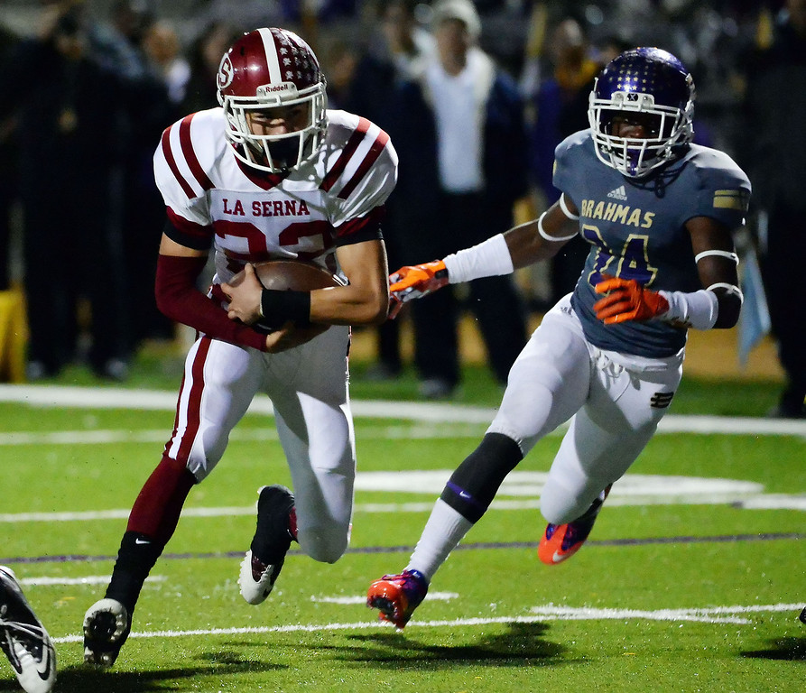 Description of . La Serna's Bryce Oliver (22) runs for a touchdown past Diamond Bar's Tyler Peterson (C) (14) in the first half of a CIF-SS playoff football game at Diamond Bar High School in Diamond Bar, Calif., on Friday, Nov. 22, 2013.   (Keith Birmingham Pasadena Star-News)