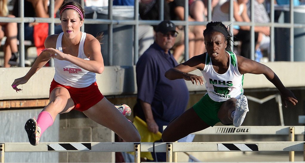 Description of . Monrovia's Syndey Mosley, right, along with Mater Dei's Emma Radan competes in the 100 meter hurdles during the CIF-SS Masters Track and Field meet at Falcon Field on the campus of Cerritos College in Norwalk, Calif., on Friday, May 30, 2014.   (Keith Birmingham/Pasadena Star-News)