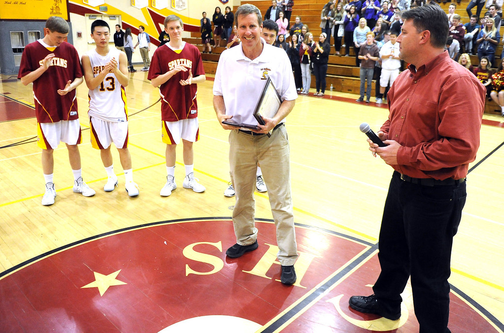Description of . La Canada head coach Tom Hofman after winning his 600th game as they defeated La Salle 73-62 during a prep basketball game at La Canada High School in La Canada, Calif., on Friday, Jan. 10, 2014. Hofman record is 600 wins and 186 losses since becoming varsity head coach in the 1986-87 season. (Keith Birmingham Pasadena Star-News)