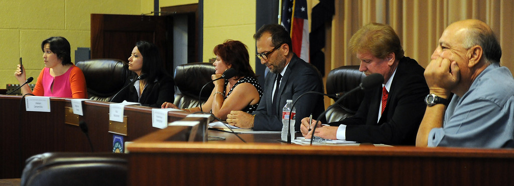 Description of . Left to Right: Incumbant board member Xilonin Cruz-Gonzalez, candidates Helen Jaramillo, Debbie Kindred, Paul Naccachian, Russell Rentschler, Linda Bermudez and Johnny Sanchez during a Azusa Unified School District candidate forum at Azusa Civic Auditorium on Tuesday, Aug. 13, 2013 in Azusa, Calif.   (Keith Birmingham/Pasadena Star-News)
