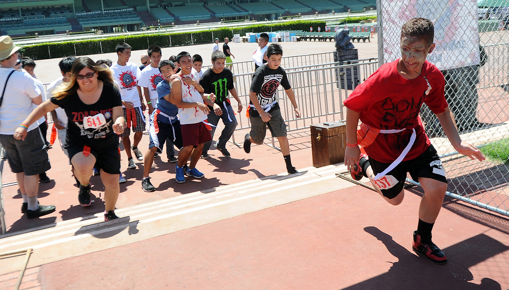 Description of . Twelve year-old Ryan Fernandez of West Covina starts the race during the Zombie Blood Run at Santa Anita Park on Saturday, Aug. 17, 2013 in Arcadia, Calif. The American Red Cross San Gabriel Pomona Valley chapter is partnering with the Zombie Blood Run to prepare the San Gabriel Valley for a disaster, even a zombie apocalypse.  (Keith Birmingham/Pasadena Star-News)