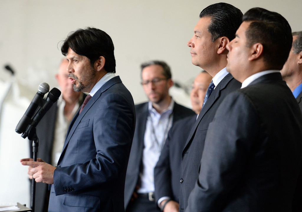 Description of . Senator Kevin de Leon, left, D-Los Angeles speaks as Sen. Alex Padilla, center, D-Pacoima and Senator Ricardo Lara, right, D-Huntington Park/ Long Beach listen as they announce the support for legislation to ban single use plastic bags during a press conference at Command Packaging in Vernon, Calif., on Friday, Jan. 24, 2014. (Keith Birmingham Pasadena Star-News)