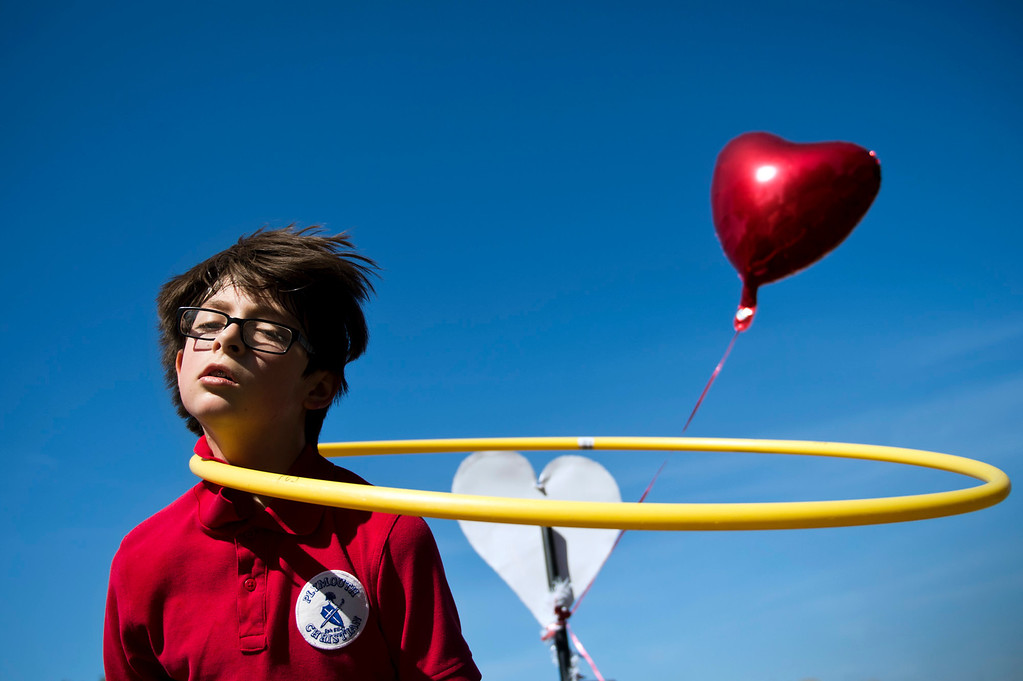 Description of . Tristan Swav, 9, spins a Hula-Hoop on his neck during an exercise at Plymouth Christian School in Whittier on Friday, Feb. 14, 2014. The school held the exercise event to promote good health. (Photo by Watchara Phomicinda/ Whittier Daily News)
