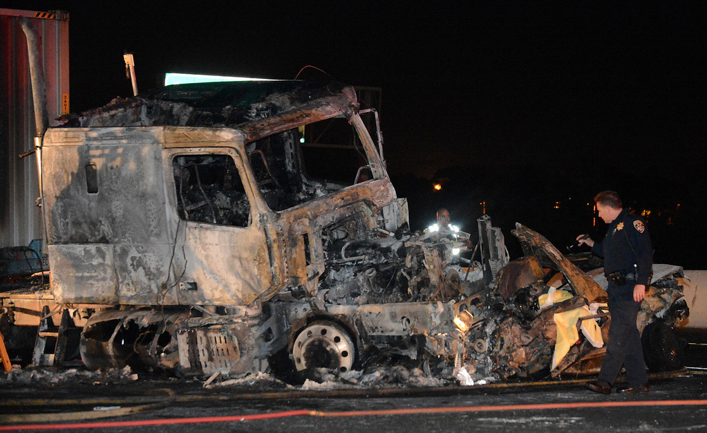Description of . CHP investigates the scene of a fatal traffic collision and fire involving a big rig Monday, August 19, 2013, on the eastbound lanes of the 10 freeway at Towne Ave in Pomona, CA. Jennifer Cappuccio Maher/Inland Valley Daily Bulletin
