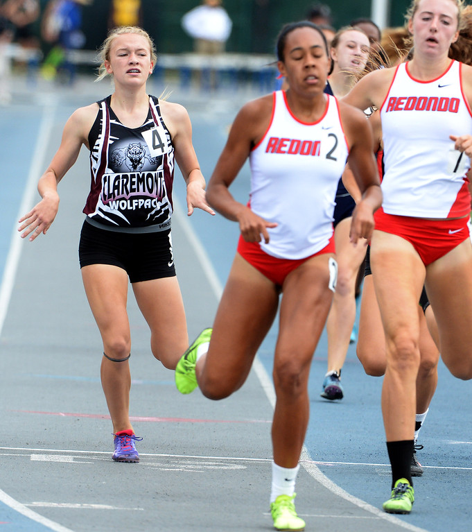 Description of . Claremont's Annie Boos competes in the division 2 800 meters race during the CIF Southern Section track and final Championships at Cerritos College in Norwalk, Calif., Saturday, May 24, 2014. 