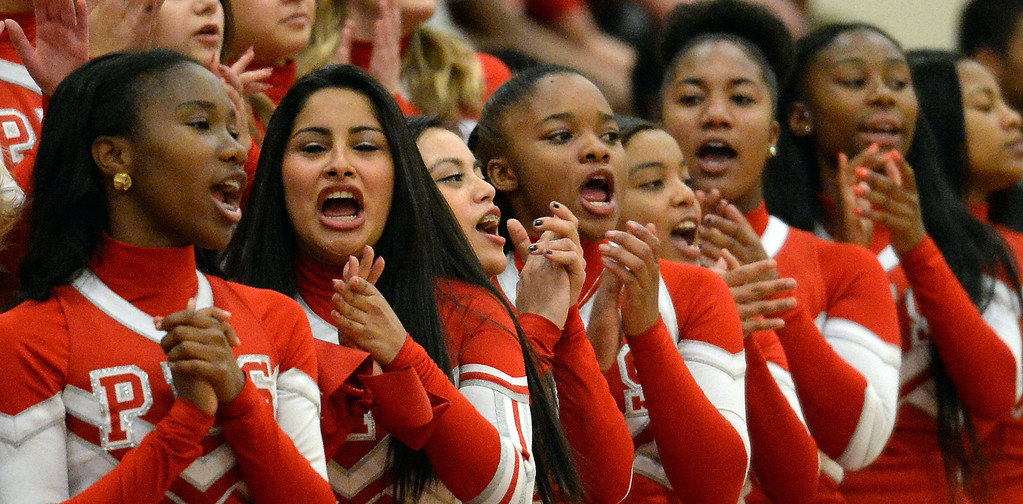 Description of . Pasadena cheerleaders perform during a time-out in the first half of a prep playoff game against Ontario at Pasadena High School in Pasadena, Calif., on Friday, Feb.21, 2014. (Keith Birmingham Pasadena Star-News)