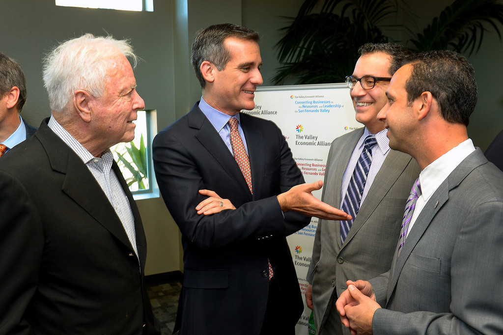 Description of . Mayor Eric Garcetti, center, talks with former Mayor Richard Riordan, left, and Councilmembers Bob Blumenfield, second from right, and Mitch Englander at a forum of exhibits and workshops presented by the Valley Economic Alliance at CSUN commemorating the 20th anniversary of the 1994 Northridge Earthquake, January 17, 2014. (Photo by Michael Owen Baker/L.A. Daily News)