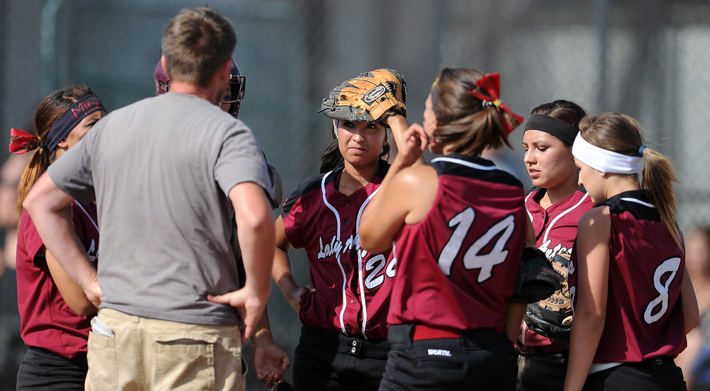 Description of . Barstow head coach Richard Johannsen talks to his team after giving-up the go ahead run in the sixth inning of a CIF-SS quarterfinal playoff softball game against Northview at Northview High School on Thursday, May 23, 2013 in Covina, Calif. Northview won 5-4.  (Keith Birmingham Pasadena Star-News)