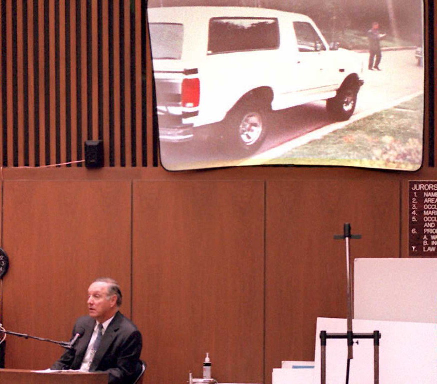 Description of . Charles Cale, a neighbor of OJ Simpson, testifies that Simpson's Ford Bronco (on screen above) was not on the street in front of the Simpson's estate between 9:30 to 9:45 pm the night of the murders 31 March in the O J Simpson murder trial. Prosecutors claim that Simpson drove the Bronco from the murder scene to his home on 12 June the night of the murders.       (POO/AFP/Getty Images)