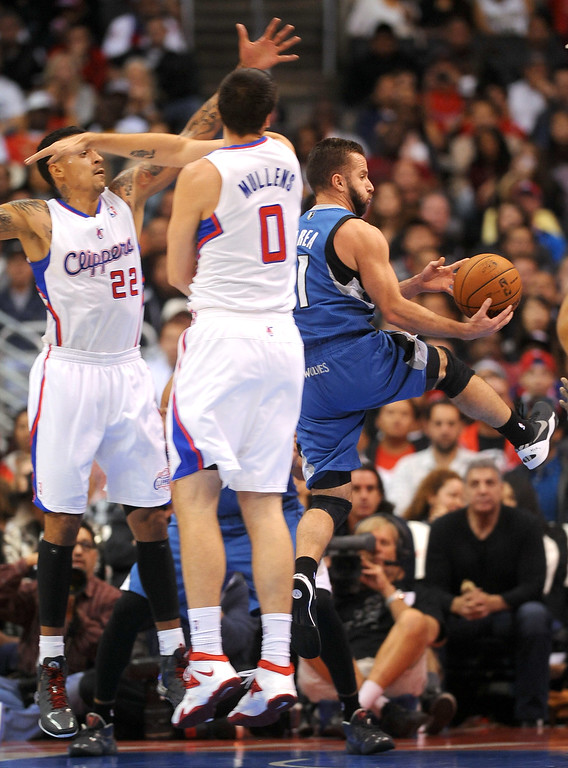 Description of . Timberwoves' Jose Barea gets up Los Angeles Clippers defenders Matt Barnes and Byron Mullens Monday, Nov. 11, 2013, in Los Angeles.  The Clippers won the game 109-107.(Andy Holzman/Los Angeles Daily News)