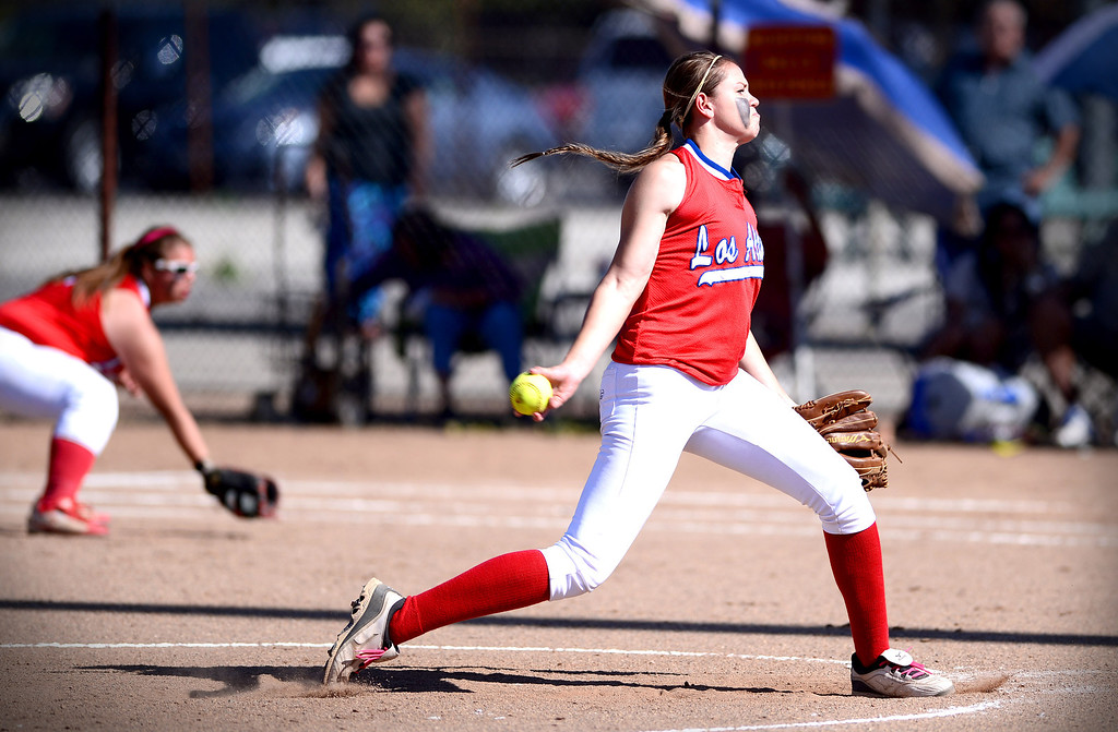 Description of . Los Altos' Celeste Wood pitches to West Covina as they defeat  West Covina 4-3 Thursday, May 15, 2014 at West Covina High School. (Photo by Sarah Reingewirtz/Pasadena Star-News)