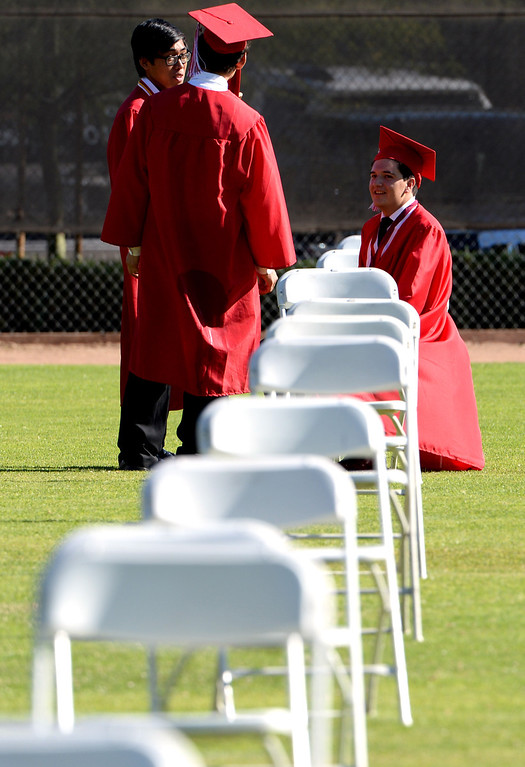 Description of . Students take a moment prior to the Whittier High School graduation at Whittier College in Whittier, Calif., on Wednesday, June 4, 2014.  (Keith Birmingham/Pasadena Star-News)
