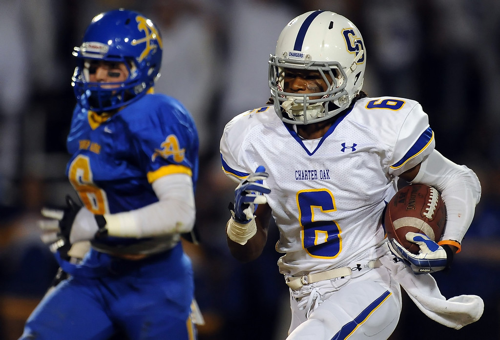 Description of . Charter Oak's Zion Echolds (6) runs for a touchdown past Bishop Amat's Joey Chavez (6) in the first half of a prep football game at Bishop Amat High School in La Puente, Calif. on Friday, Sept. 20, 2013.    (Photo by Keith Birmingham/Pasadena Star-News)