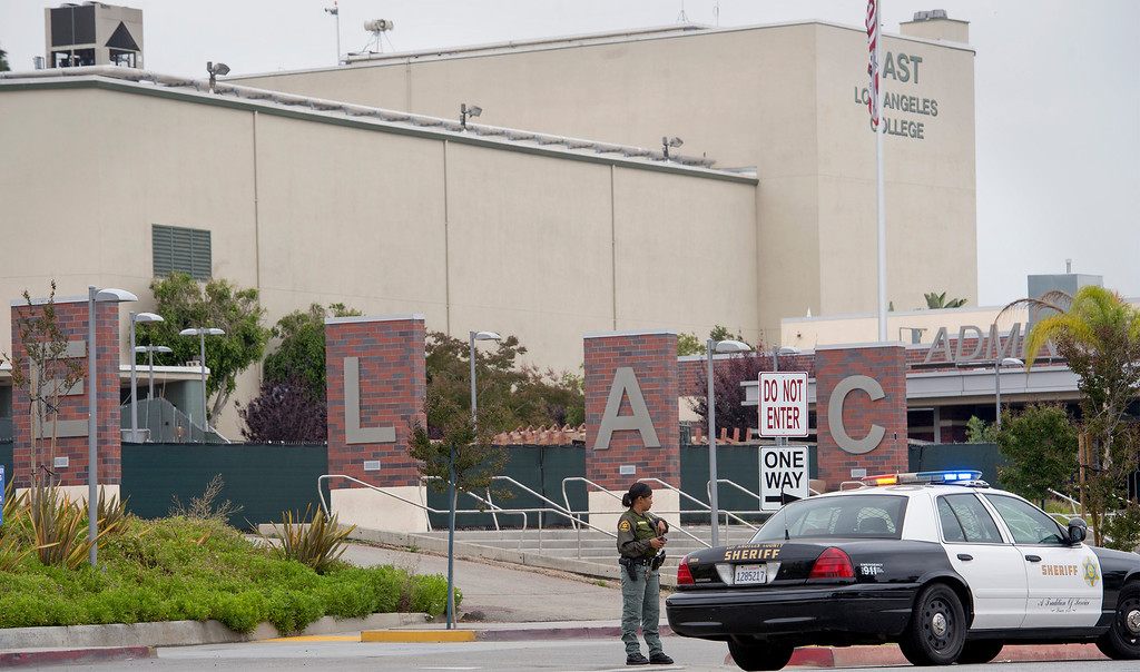 Description of . Los Angeles County Sheriff's Deputies,  Security Officers and Los Angeles School Police lockdown East Los Angeles Community College after a man threatened to shoot up that campus as well as Santa Monica Community College May 16, 2013.   (SGVN/Staff photo by Leo Jarzomb)