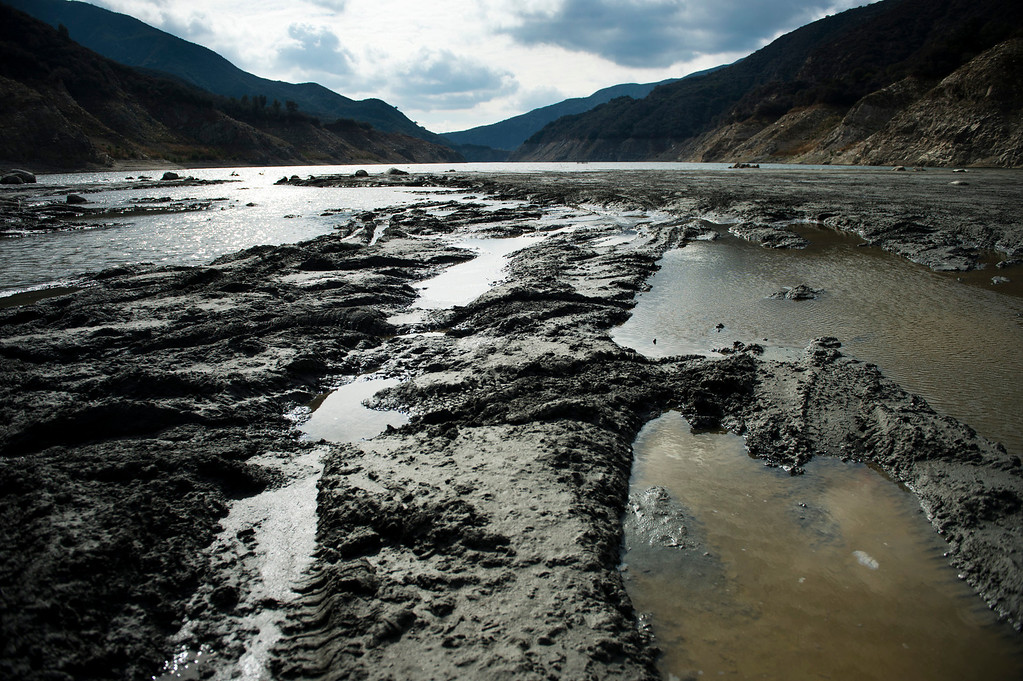 Description of . The lack of rainfall exposes the muddy bottom of the San Gabriel River just south of San Gabriel Dam in the Angeles National Forest on Friday, Feb. 7, 2014.  Southern California is in the third year of drought. (Photo by Watchara Phomicinda/ San Gabriel Valley Tribune)