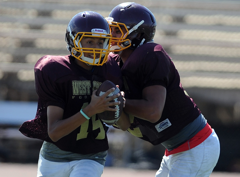 Description of . OL/DL Matthew Garcia, right, during football practice at West Covina High School on Tuesday, Aug. 20, 2013 in West Covina, Calif.   (Keith Birmingham/Pasadena Star-News)