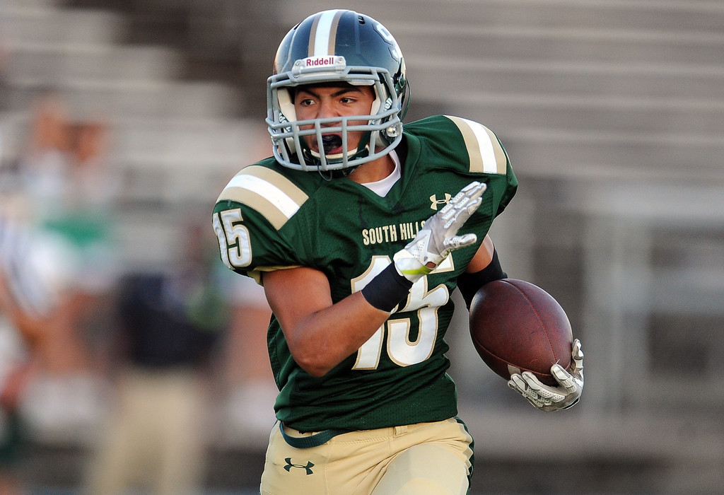Description of . South Hills' Carlos Delgado runs for a first down against Bonita in the first half of a prep football game at Covina District Field in Covina, Calif. on Friday, Sept. 6, 2013.   (Photo by Keith Birmingham/Pasadena Star-News)