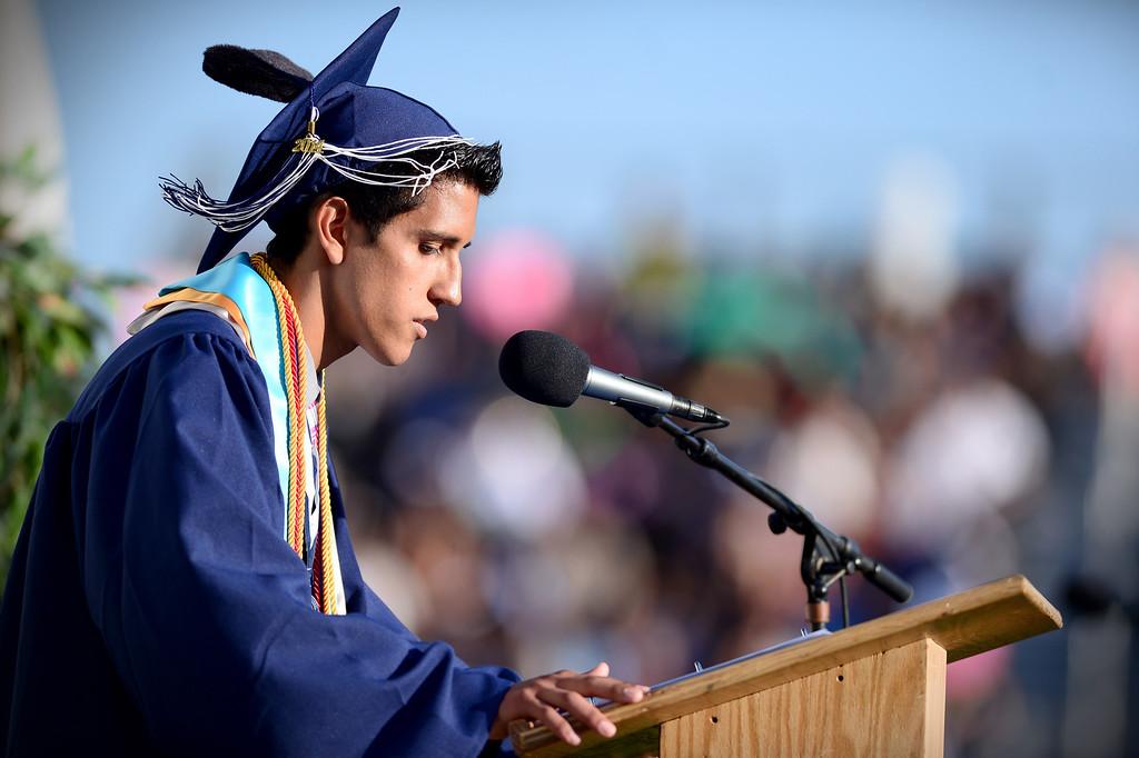 Description of . Senior Class President Dominick Rubio speaks during Duarte High School's commencement ceremony Thursday night,  June 12, 2014 at the Duarte school. (Photo by Sarah Reingewirtz/Pasadena Star-News)