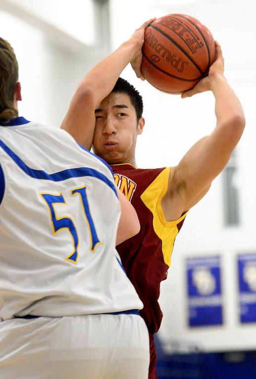 Description of . Wilson's Justin Lee (11) passes as Wilson defeats San Dimas 45-43 Friday night, January 10, 2014 at San Dimas High School.  (Photo by Sarah Reingewirtz/Pasadena Star-News)