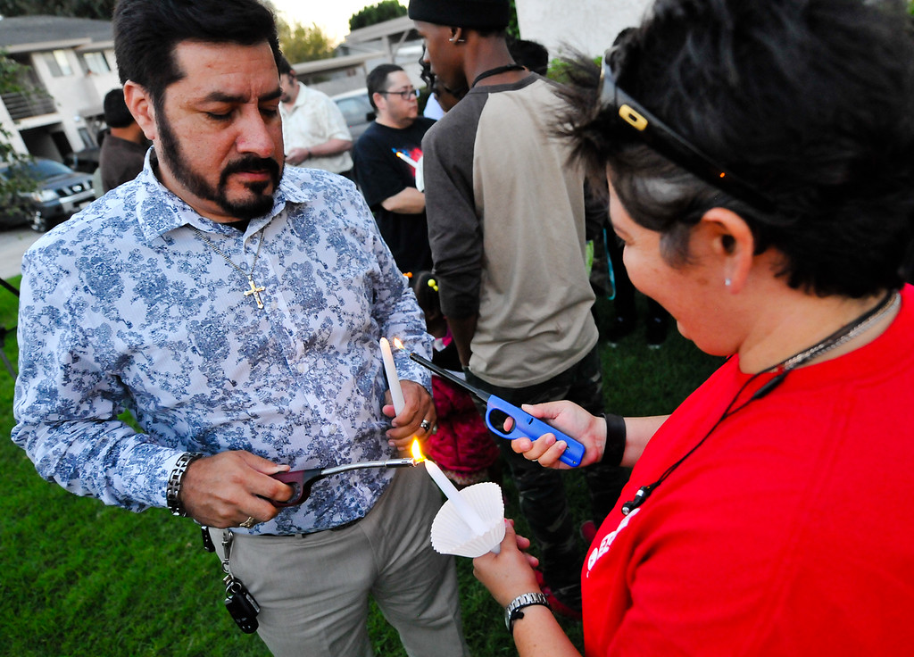 Description of . Friends and supporters of Domonique Newburn, a Fontana transgender who was found dead on Tuesday, hold a candlelight vigil outside of Newburn's residence in Fontana on Wednesday, Aug. 21, 2013. Police have not made an arrest in the case, but say a man seen leaving Newburn's home in a Mercedes may be the suspect in the killing. The vehicle, which was found at Perris Hill Park Wednesday in San Bernardino, is believed to belong to Newburn. (Rachel Luna / Staff Photographer)