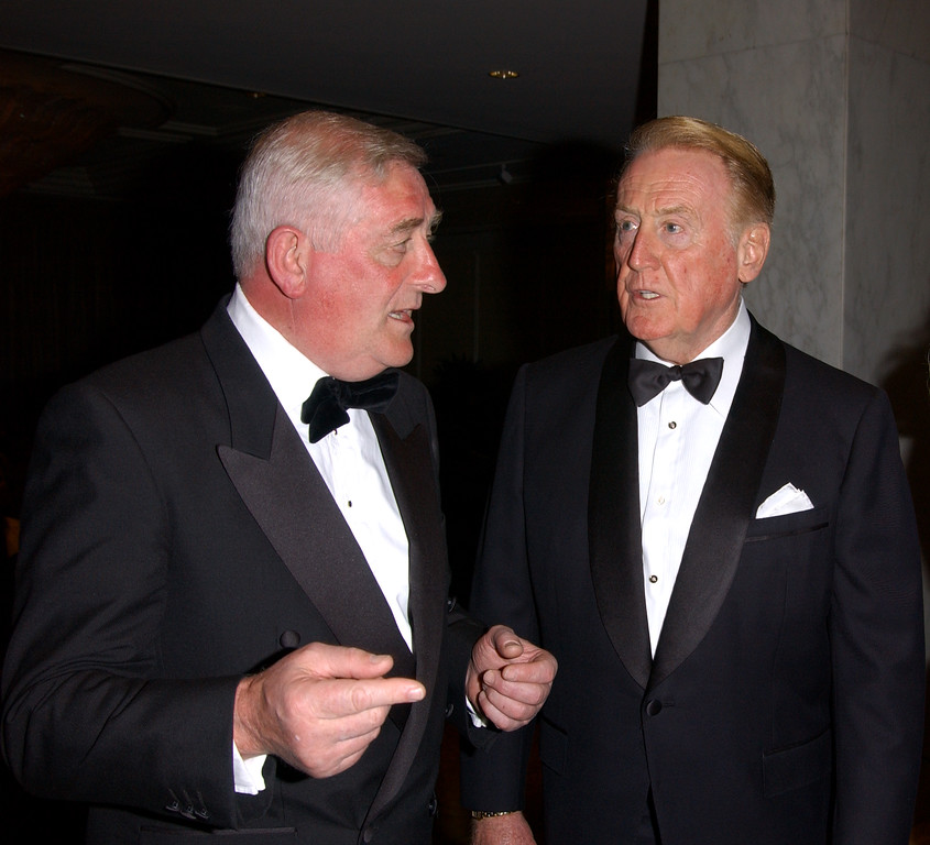 Description of . Sportscaster Vin Scully (R) converses with the former Mayor of Dublin at the American Ireland Fund Gala April 17, 2002 in Los Angeles, CA. (Photo by Sebastian Artz/Getty Images)
