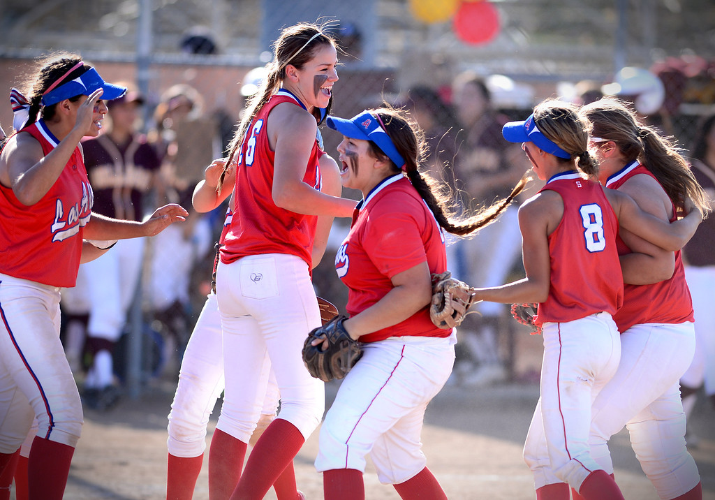 Description of . Los Altos celebrates with pitcher Celeste Wood, center, after defeating West Covina 4-3 Thursday, May 15, 2014 at West Covina High School. (Photo by Sarah Reingewirtz/Pasadena Star-News)