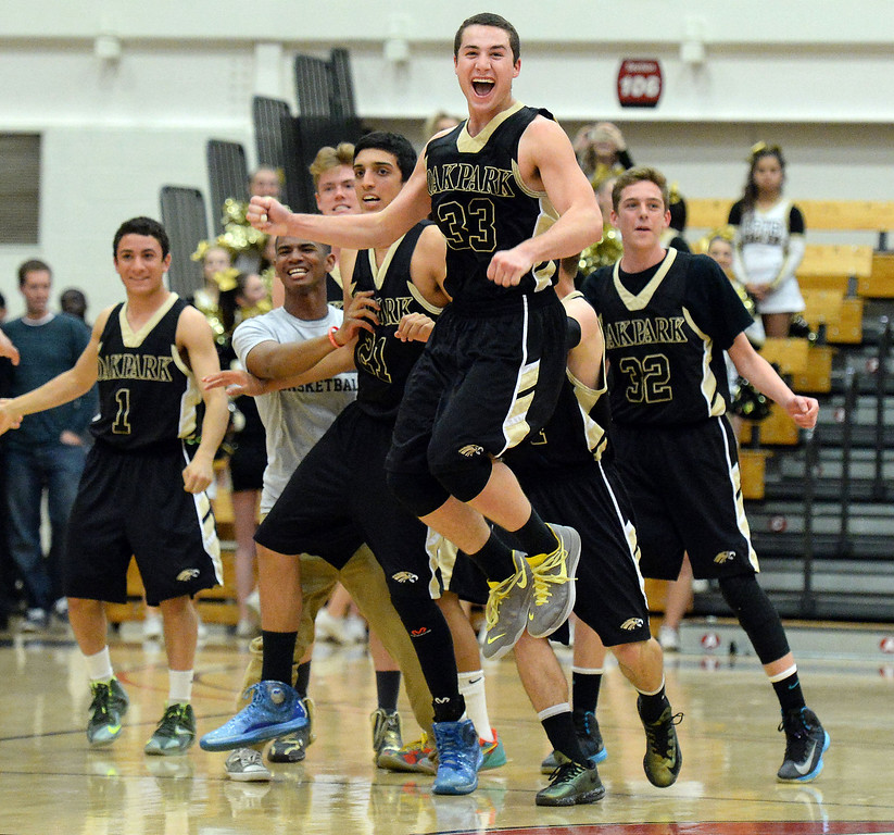 Description of . Oak Park celebrates after defeating St. Francis 60-53 during a CIF-SS Division 3A Championship basketball game at the Felix Event Center on the campus of Azusa Pacific University in Azusa, Calif., on Friday, March 7, 2014.  (Keith Birmingham Pasadena Star-News)