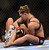 UFC women's bantamweight champion Ronda Rousey battles Liz Carmouche during their UFC 157 match at the Honda Center in Anaheim, CA Saturday, February 23, 2013. Rousey beat Carmouche via first round submission. (Hans Gutknecht/Staff Photographer)